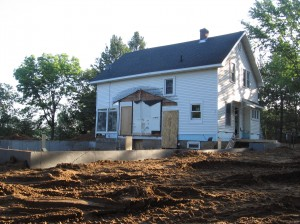 Exterior View, poured and backfilled foundation